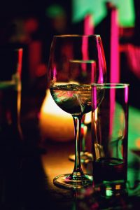 white wine in glass red lights