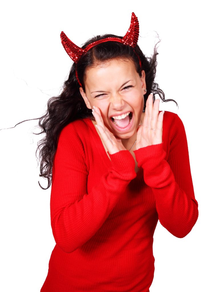 Girl in devil horns and red sweater