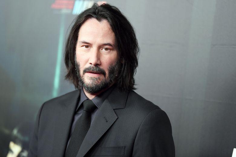 Keanu Reeves in a dark suit